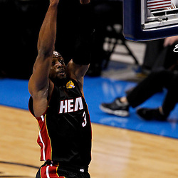 Jun 14, 2012; Oklahoma City, OK, USA; Miami Heat shooting guard Dwyane Wade (3) dunks against the Oklahoma City Thunder during the first quarter of game two in the 2012 NBA Finals at Chesapeake Energy Arena. Mandatory Credit: Derick E. Hingle-US PRESSWIRE