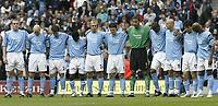 Photo. Aidan Ellis.<br />Manchester City v Arsenal.<br />Barclays Premiership.<br />25/09/2004.<br />Manchester City observe  a minute silence for Brian Clough