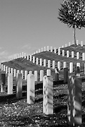The gravestones are lined up in the Sante Fe National Cemetery in New Mexico.