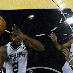 Jun 13, 2013; San Antonio, TX, USA; San Antonio Spurs small forward Kawhi Leonard (2) shoots against the Miami Heat during the second half of game four of the 2013 NBA Finals at the AT&T Center. The Miami Heat defeated the San Antonio Spurs 109-93. Mandatory Credit: Derick E. Hingle-USA TODAY Sports