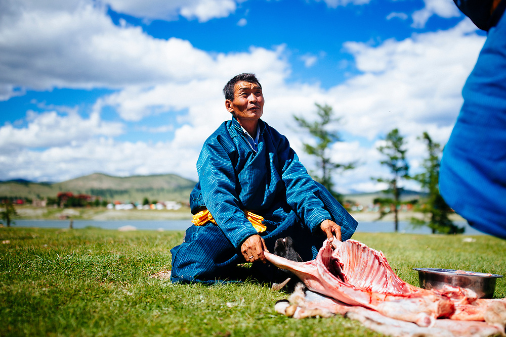 Mongolian men slaughter a goat for dinner at their home in Khovsgol Lake, in northern Mongolia.