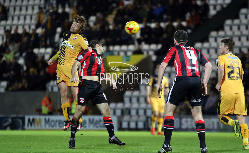 Lawrence Wilson challenges during the Sky Bet League 2 match between Morecambe and Cambridge United at the Globe Arena, Morecambe, England on 24 November 2015. Photo by Pete Burns.