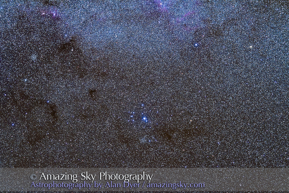 Southern Pleiades (IC 2602) area south of Carina Nebula. Open cluster Mel 101 below IC 2602 and IC 2714 cluster at upper left. Taken from San Pedro de Atacama, Chile, May 2011 with Canon 7D (unmodified) and 135mm Canon telephoto lens at f/2.8 for stack of 5 x 2 minute exposures at ISO 1250.