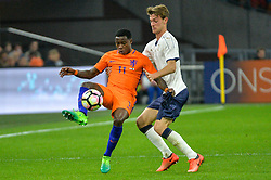 March 28, 2017 - Amsterdam, Netherlands - Quincy Promes from the Netherlands is challenged by Alessio Romagnoli from Italy during the friendly match between Netherlands and Italy on March 28, 2017 at the Amsterdam ArenA in Amsterdam, Netherlands. (Credit Image: © Andy Astfalck/NurPhoto via ZUMA Press)