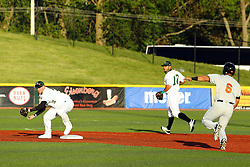 14 May 2016: Robert Peruki gets the first throw on a double play attempt to put out the Slammers runner during a Frontier League Baseball game between the Joliet Slammers and the Normal CornBelters at Corn Crib Stadium on the campus of Heartland Community College in Normal Illinois