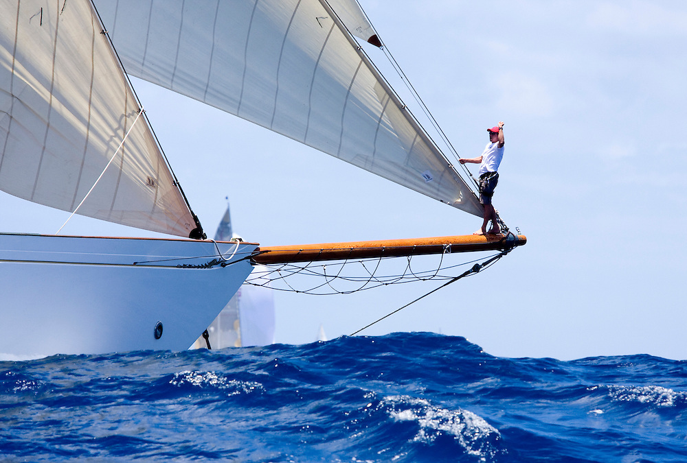 The unidentified bow man of the gaff rigged schooner yacht Altair signals to the driver during the 2008 Antigua Classic Yacht Regatta . This race is one of the worlds most prestigious traditional yacht races. It takes place annually off the costa of Antigua in the British West Indies.