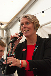 30/09/2017. Manchester, UK. Louise Regan, president of the National Educational Union, speaks at the People's Event marquee in Piccadilly Gardens, Manchester, during a Stop The War event on the eve of The Conservative Party Conference. Pro-peace, anti-austerity, anti-war protests, including rallies, public meetings, comedy, music, & culture, take place during the four days of the Conservative Party Conference in Manchester, UK. 1st - 4th Oct 2017. The protest festival has been organised by The People's Assembly. Photo credit: Graham M. Lawrence/LNP