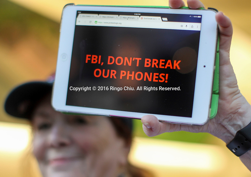 A demonstrator hold up her iPad during a rally in support of data privacy outside the Apple store, Tuesday, Feb. 23, 2016, in Los Angeles. Protesters assembled in more than 30 cities around the world to lash out at the FBI for obtaining a court order that requires Apple to make it easier to unlock an encrypted iPhone used by a gunman in December's mass murders in California.(Photo by Ringo Chiu/PHOTOFORMULA.com)<br /> <br /> Usage Notes: This content is intended for editorial use only. For other uses, additional clearances may be required.