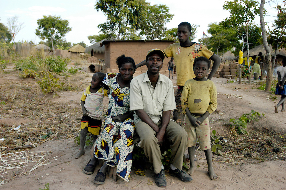 Jurindo Victor Hishika, 48, his wife and three of his 10 children in a village cleared of landmines by Mines Advisory Group (MAG) in the eastern province of Moxico. MAG cleared landmines along the road from the provincial capital Luena to Lumbalagimbo, on the border with Zambia, allowing for the reconstruction of bridges and the repair of the road..Chifoio, Moxico Province, Angola. 23/07/2009..Photo © J.B. Rusell