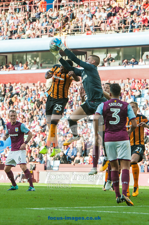 Aston Villa goalkeeper Sam Johnstone collects the ball ahead of a challenge from Fraizer Campbell of Hull City during the Sky Bet Championship match at Villa Park, Birmingham<br /> Picture by Matt Wilkinson/Focus Images Ltd 07814 960751<br /> 05/08/2017