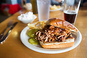 A pulled pork sandwich in a restaurant in Johnson City, Texas