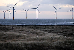 © Licensed to London News Pictures. <br /> 11/01/2017. <br /> Redcar, UK.  <br /> <br /> Strong winds gust across the grasses on the dunes at South Gare near Redcar as heavy winds affect many parts of the country. <br /> <br /> <br /> <br /> <br /> Photo credit: Ian Forsyth/LNP