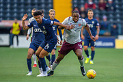 Uche Ikpeazu (#19) of Heart of Midlothian FC runs past Nicholas Hamalainen (#14) of Kilmarnock FC during the Ladbrokes Scottish Premiership match between Kilmarnock FC and Heart of Midlothian FC at Rugby Park, Kilmarnock, Scotland on 23 November 2019.