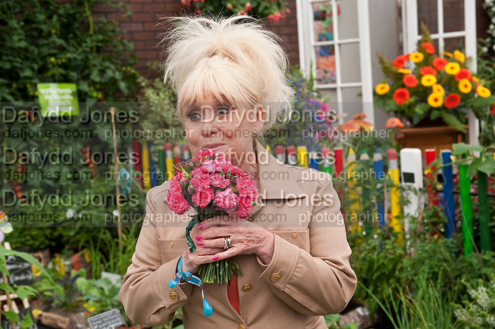 BARBARA WINDSOR, PRESS PREVIEW. The RHS Chelsea Flower Show 2011. The Royal Hospital grounds. Chelsea. London. 23 May 2011. <br /> <br />  , -DO NOT ARCHIVE-© Copyright Photograph by Dafydd Jones. 248 Clapham Rd. London SW9 0PZ. Tel 0207 820 0771. www.dafjones.com.