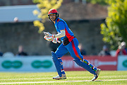 Afghan cricketer Hashmatullah Shaidi runs between the wickets during the One Day International match between Scotland and Afghanistan at The Grange Cricket Club, Edinburgh, Scotland on 10 May 2019.
