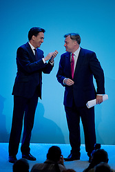© London News Pictures. 23/09/2013 . Brighton, UK. LAbour Party leader ED MILIBAND (Left) on stage with Shadow Chancellor of the Exchequer, ED BALLS (right) after ED BALLS delivered a speech on the British economy on day two of the Labour Party Annual Conference in Brighton. Photo credit : Ben Cawthra/LNP