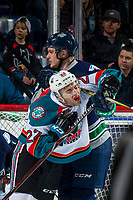 KELOWNA, CANADA - JANUARY 30: Matt Barberis #22 of the Kelowna Rockets gets a high stick to the neck by the Seattle Thunderbirds  on January 30, 2019 at Prospera Place in Kelowna, British Columbia, Canada.  (Photo by Marissa Baecker/Shoot the Breeze)