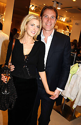 TV presenter DONNA AIR and DAMIAN ASPINALL at a party to celebrate the opening of the new H&M Flagship Store at 17-21 Brompton Road, London SW3 on 23rd March 2005.<br />