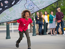April 27, 2017 - Washington, District of Columbia, U.S - Youth plaintiff LEVI DRAHEIM plays under a colorful cloth on the sidewalk in front of the Supreme Court in Washington, D.C., before a a press conference. Draheim is one of 21 plaintiffs represented by Our Children's Trust in a landmark federal lawsuit which accuses the federal government of violating their constitutional rights. (Credit Image: © Robin Loznak via ZUMA Wire)