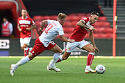 Nathan Baker (6) of Bristol City on the attack being chased by Ben Osborn (11) of Nottingham Forset during the EFL Sky Bet Championship match between Bristol City and Nottingham Forest at Ashton Gate, Bristol, England on 4 August 2018. Picture by Graham Hunt.
