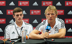 KUALA LUMPUR, MALAYSIA - Friday, July 15, 2011: Liverpool's Jack Robinson and Dirk Kuyt during a promotional event at the Adidas store at the Mid Valley Shopping Centre on day five of the club's Asia Tour. (Photo by David Rawcliffe/Propaganda)
