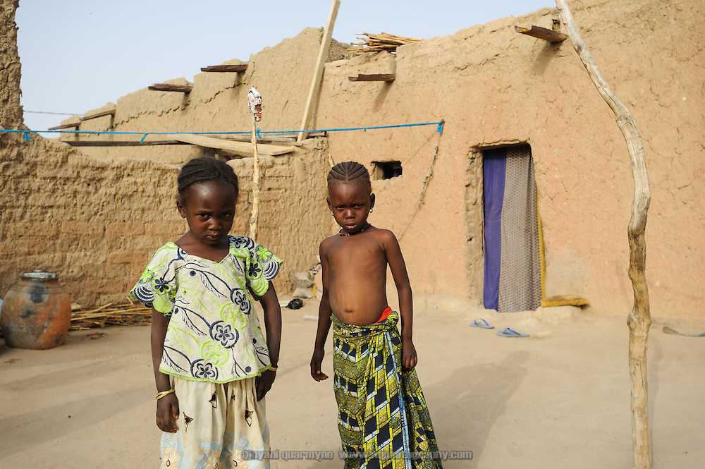 Children at the home of Alhaji Maman Bilali in Tessaoua in Niger. Following a failed harvest, Halima Moussa and her children have moved in with Bilali and his large family, as her husband has migrated to Maradi in search of work.