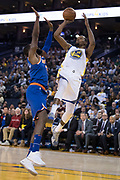 January 23, 2018; Oakland, CA, USA; Golden State Warriors forward Kevin Durant (35) shoots the basketball against New York Knicks forward Tim Hardaway Jr. (3) during the fourth quarter at Oracle Arena. The Warriors defeated the Knicks 123-112.