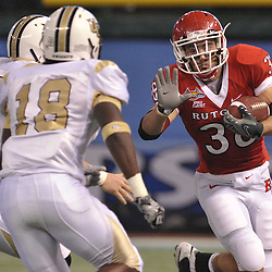 Dec 19, 2009; St. Petersburg, Fla., USA; Rutgers running back Joe Martinek (38) squares up against UCF defensive end Bruce Miller (49) and quarterback Andy Slowik (18) during NCAA Football action in Rutgers' 45-24 victory over Central Florida in the St. Petersburg Bowl at Tropicana Field.
