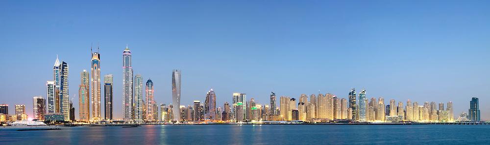 Evening skyline panorama view of skyscrapers in Marina district of Dubai United Arab Emirates