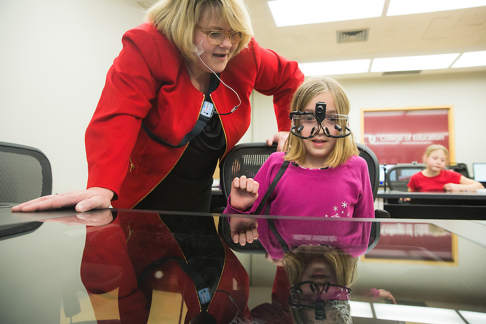 Ava Grow, 8, a third-grade student at Sunnyside Elementary in Pullman, Wash., wears a set of eye-tracking glasses as she begins to understand a computer coding process as her teacher Laura Grant explains it to her during a field trip to the Washington State University neurocognition sciene lab Monday, Feb. 22, 2016.