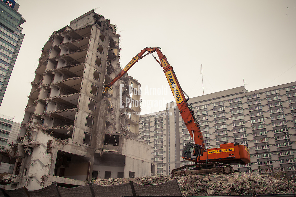 19/11/2012 - Warsaw, Poland. A Post-World War 2 communist built concrete building being torn down by a demolition digger. Photo by Rob Arnold