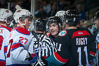 KELOWNA, CANADA - NOVEMBER 9: Kevin Crowell linesman gets between Curtis Lazar #27 of the Edmonton Oil Kings and Carter Rigby #11 of the Kelowna Rockets on November 9, 2013 at Prospera Place in Kelowna, British Columbia, Canada.   (Photo by Marissa Baecker/Shoot the Breeze)  ***  Local Caption  ***