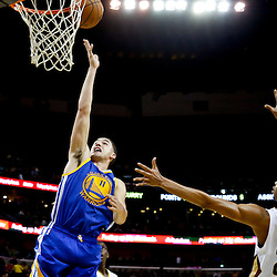 Nov 26, 2013; New Orleans, LA, USA; Golden State Warriors shooting guard Klay Thompson (11) shoots over New Orleans Pelicans power forward Anthony Davis (23) during the second half of a game at New Orleans Arena. The Warriors defeated the Pelicans 102-101. Mandatory Credit: Derick E. Hingle-USA TODAY Sports