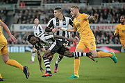Christian Atsu (Newcastle United) keeps on his feet despite the challenge by Tom Clarke (Preston North End)  during the EFL Cup 4th round match between Newcastle United and Preston North End at St. James's Park, Newcastle, England on 25 October 2016. Photo by Mark P Doherty.