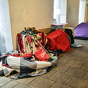 A homeless camps and a homeless sleeping on the floor without any cover in a busy westend in fact, At least 320,000 homeless people in Britain, and over 600 dead on the street, on 1st June 2019, London, UK.