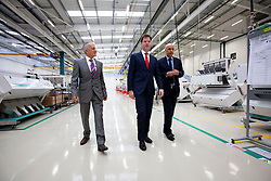 © Licensed to London News Pictures. 08/10/2013. London, UK. The British Deputy Prime Minister, Nick Clegg (C) walks with Robert Egli (L), the managing director of Buhler AG UK, and Hamid Kefayati (R), the managing director of Buhler Sortex Ltd, before delivering a speech on Britain and Europe at Buhler Sortex Limited in East London today (08/10/2013). Photo credit: Matt Cetti-Roberts/LNP