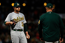 SAN FRANCISCO, CA - AUGUST 13: Brett Anderson #30 of the Oakland Athletics reacts during a mound visit with pitching coach Scott Emerson #14 during the sixth inning against the San Francisco Giants at Oracle Park on August 13, 2019 in San Francisco, California. The San Francisco Giants defeated the Oakland Athletics 3-2. (Photo by Jason O. Watson/Getty Images) *** Local Caption *** Brett Anderson; Scott Emerson