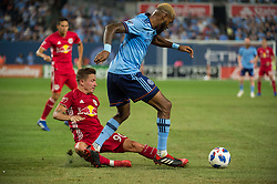 August 22, 2018 - Bronx, New York, United States - New York Red Bulls midfielder MARC RZATKOWSKI (90) slides for the ball against New York City defender SEBASTIEN IBEAGHA (33) during a regular season match at Yankee Stadium in Bronx, NY.  New York City FC tie the New York Red Bulls 1 to 1 (Credit Image: © Mark Smith via ZUMA Wire)