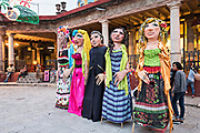 giant paper-mache puppets called mojigangas line up for a parade during the week long fiesta of the patron saint Saint Michael September 26, 2017 in San Miguel de Allende, Mexico.