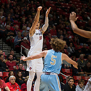 10 November 2017:  The San Diego State Aztecs men's basketball team opens up the season against San Diego Christian. San Diego State Aztecs forward Max Montana (10) attempts a three point shot in the first half. The Aztecs lead the Hawks 46-24 at the half.<br /> www.sdsuaztecphotos.com
