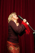 Singer on stage with microphone.