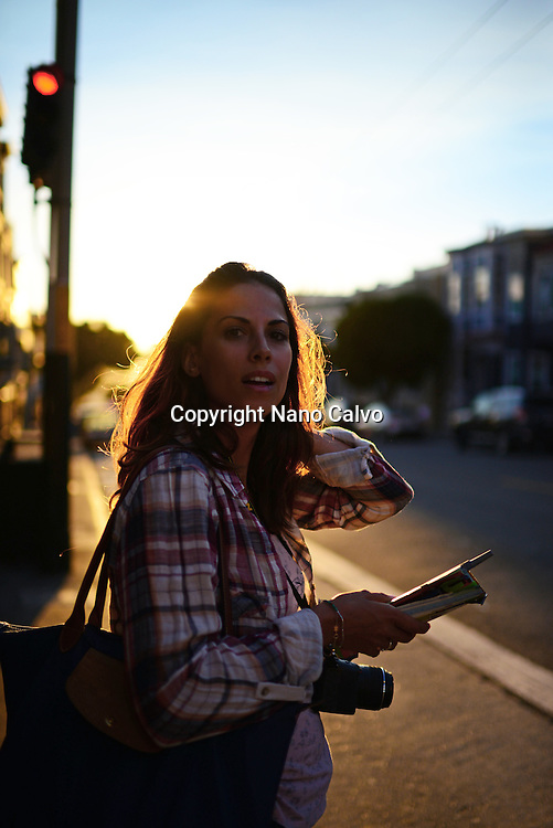 Young woman in the streets of San Francisco at sunset.