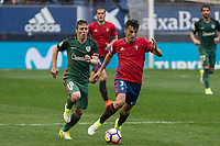 Iker Muniain of Athletic Club and Imanol Garcia of Club Atletico Osasuna during the match of  La Liga between Club Atletico Osasuna and Athletic Club Bilbao at El Sadar Stadium  in Pamplona, Spain. April 01, 2017. (ALTERPHOTOS / Rodrigo Jimenez)