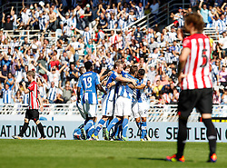 02.10.2011, Stadion Anoeta, San Sebastian Donostia, ESP, Primera Division, Real Sociedad vs Athletic Bilbao, im Bild Real Sociedad's players celebrates goal in presence of Atletic de Bilbao's Iker Muniain (l) and Fernando Amorebieta (r) // during Primera Division football match between Real Sociedad and Athletic Bilbao at Anoeta stadium in San Sebastian Donostia, Spain on 2/10/2011. EXPA Pictures © 2011, PhotoCredit: EXPA/ Alterphoto/ Acero +++++ ATTENTION - OUT OF SPAIN/(ESP) +++++