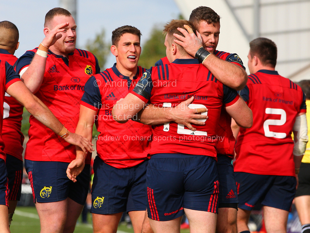 Munster players congratulate Rory Scannell after he scores a try. European Rugby Champions cup match, pool one, Munster Rugby v Glasgow Warriors at Thomond Park in Limerick , Ireland on Saturday 22nd October 2016.<br /> pic by  John Halas, Andrew Orchard sports photography.