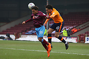 Scunthorpe United midfielder Duane Holmes (19) and Oldham Athletic forward Aaron Holloway (10)  during the EFL Sky Bet League 1 match between Scunthorpe United and Oldham Athletic at Glanford Park, Scunthorpe, England on 3 March 2018. Picture by Mick Atkins.