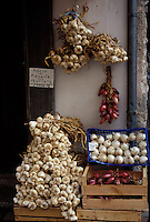 dried garlic and onions in an Italian market