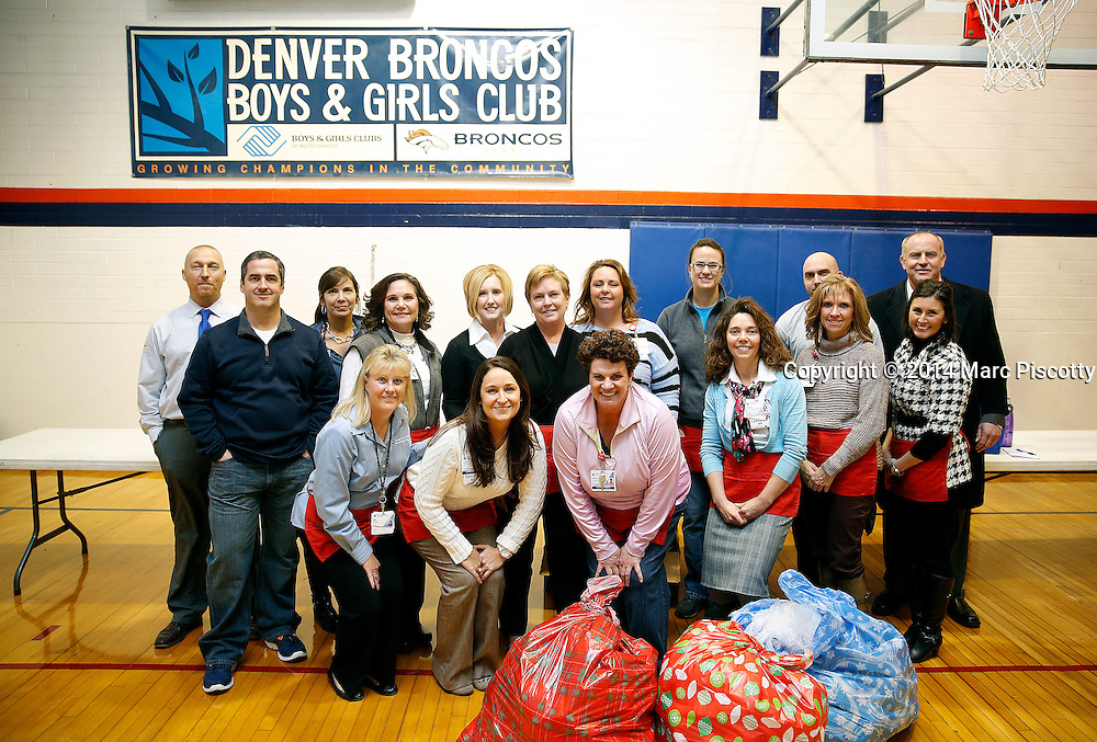SHOT 12/15/14 5:36:05 PM - Medical Center of Aurora Executive Team members and Directors volunteered their time serving dinner and handing out gifts and toys at the Denver Broncos Boys & Girls Club in Montbello Monday evening. (Photo by Marc Piscotty / © 2014)