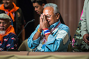 18 MAY 2014 - BANGKOK, THAILAND: SUTHEP THAUGSUBAN greets representatives of state enterprises at the beginning of a meeting he called at Government House in Bangkok. Suthep called representatives state enterprises to a meeting at his office in Government House, normally the office of the Prime Minister, to make assignments for the coming week. Suthep has pledged to overthrow the government of interim caretaker Prime Minister Niwatthamrong Boonsongphaisan, a member of former Prime Minister Yingluck Shinawatra's inner circle. Niwatthamrong became PM after the courts ousted Yingluck. Suthep has pledged to remove the Shinawatra family from Thai politics by May 27 or he will turn himself into police to face prosecution.      PHOTO BY JACK KURTZ
