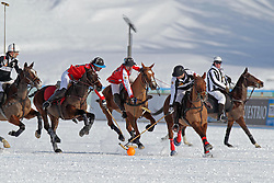Gonzalo Bourdieu of team Germany going for the ball chased by Frederico Bachmann and Augustin Martinez of the Switzerland<br /> St.Moritz Polo World Cup On Snow 2011<br /> © Dirk Caremans